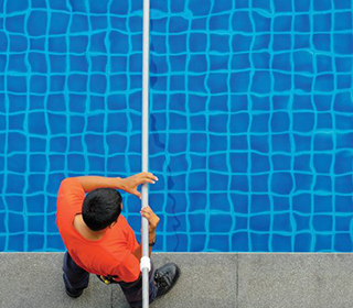 A man cleaning his pool, Jozi Pools can do this for you